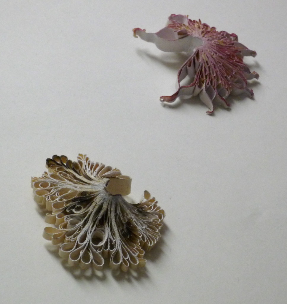 Flora Vagi, jewellery made from wood, paper and old books